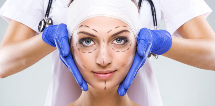 Plastic surgery - Beautiful woman face, with surgical markings